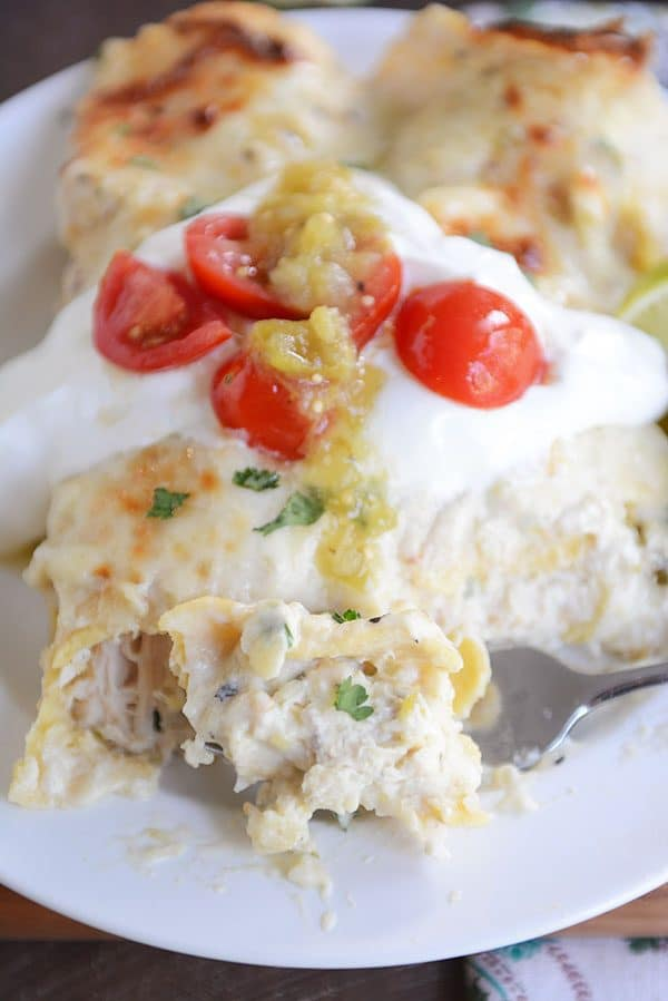 If you haven't had these green chile chicken enchiladas, you are missing out! The quick and easy from-scratch cheesy, creamy white sauce takes them over the top!